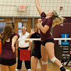Jen Forbus - The Morning Journal<br> Rocky River's Marissa Smiley taps the volleyball over the net against North Olmsted on Sept. 8.