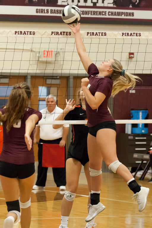 . Jen Forbus - The Morning Journal<br> Rocky River\'s Marissa Smiley taps the volleyball over the net against North Olmsted on Sept. 8.