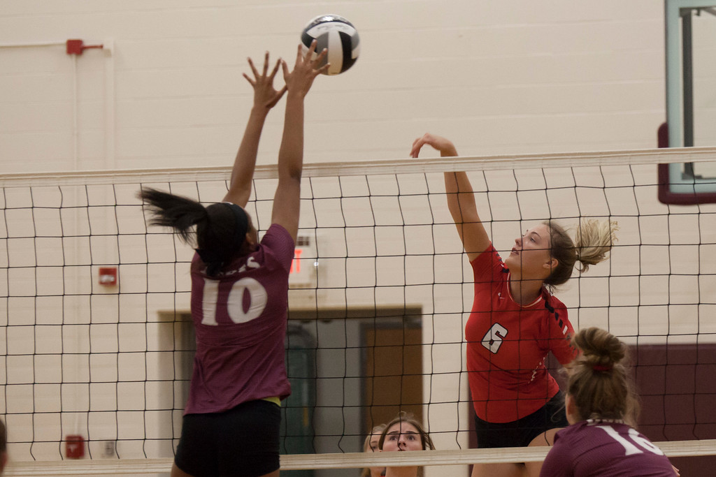 . Jen Forbus - The Morning Journal<br> Wellington\'s Jalen Gibbs gets hands up as Madelyn Bochenek of Fairview goes for a hit on Sept. 8.