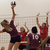 Jen Forbus - The Morning Journal<br> Wellington's Alexis Lehmkuhl hits the ball over the net as Fairview's Abby Kuyper and Jade Peace leap to block on Sept. 8.