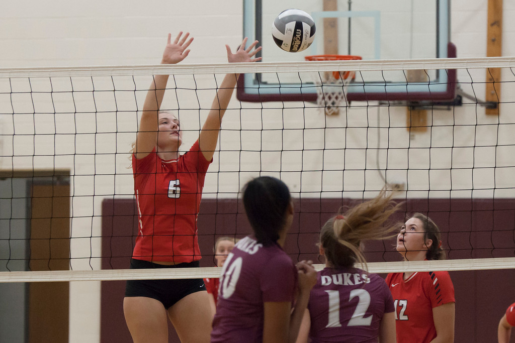 . Jen Forbus - The Morning Journal<br> Fairview\'s Madelyn Bochenek attempts a block against the Wellington Dukes on Sept. 8.