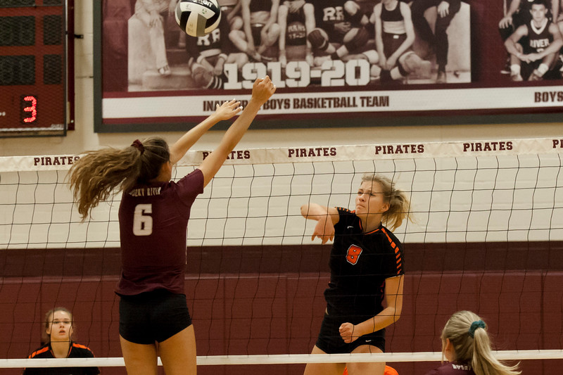 Jen Forbus - The Morning Journal<br> North Olmsted's Zinta Frigic spikes the ball past Rocky River's Ava Rauser on Sept. 8.
