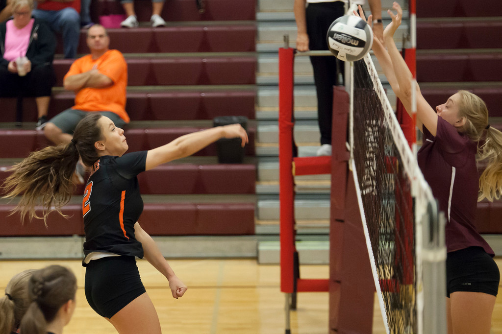 . Jen Forbus - The Morning Journal<br> North Olmsted\'s JordanTessmer spikes the ball straight into the block of Rocky River\'s Rachael Waite on Sept. 8.