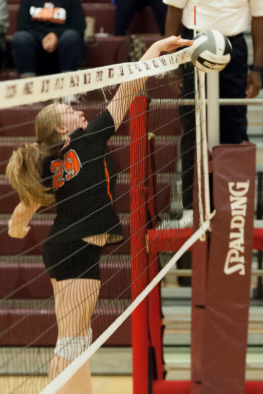 . Jen Forbus - The Morning Journal<br> North Olmsted\'s Rachel Kennedy tips the ball over the net against Trintiy on Sept. 8.