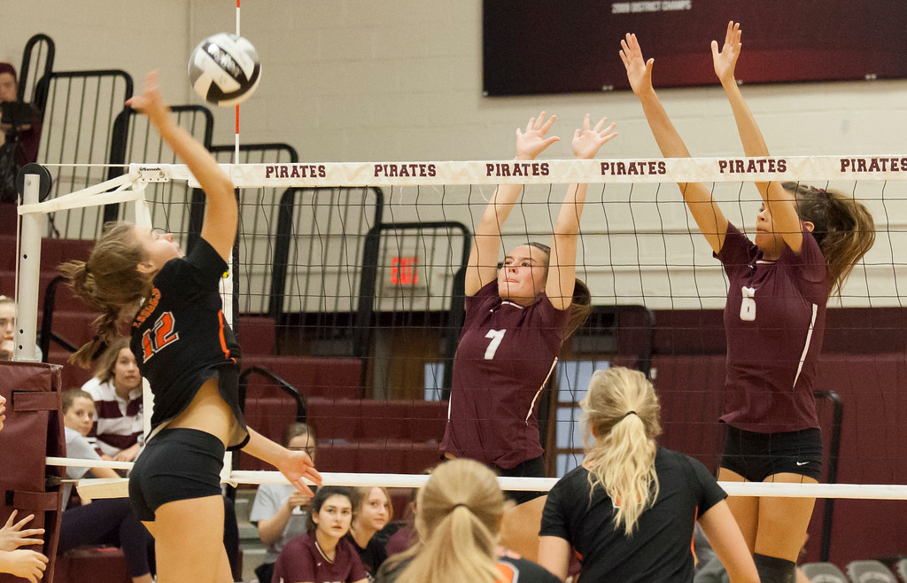 . Jen Forbus - The Morning Journal<br> North Olmsted\'s Jessica Yelsik tries to spike around the block of Rocky River\'s Ava Rauser (6) and Molly Sheridan on Sept. 8.