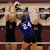 Jen Forbus - The Morning Journal<br> North Olmsted's Zinta Frigic, left, and Rachel Kennedy block a shot from Trinity's Shelby Brownfield on Sept. 8.