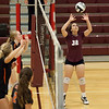 Jen Forbus - The Morning Journal<br> North Olmsted waits in anticipation as Rocky River's Emily Slyman sets the ball to a teammate on Sept. 8.