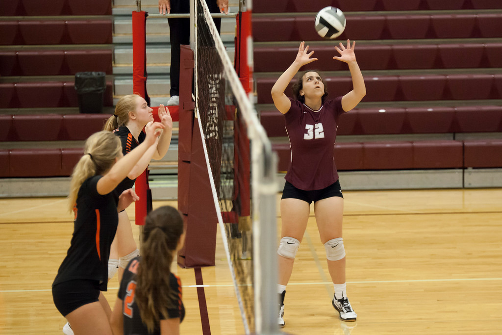 . Jen Forbus - The Morning Journal<br> North Olmsted waits in anticipation as Rocky River\'s Emily Slyman sets the ball to a teammate on Sept. 8.