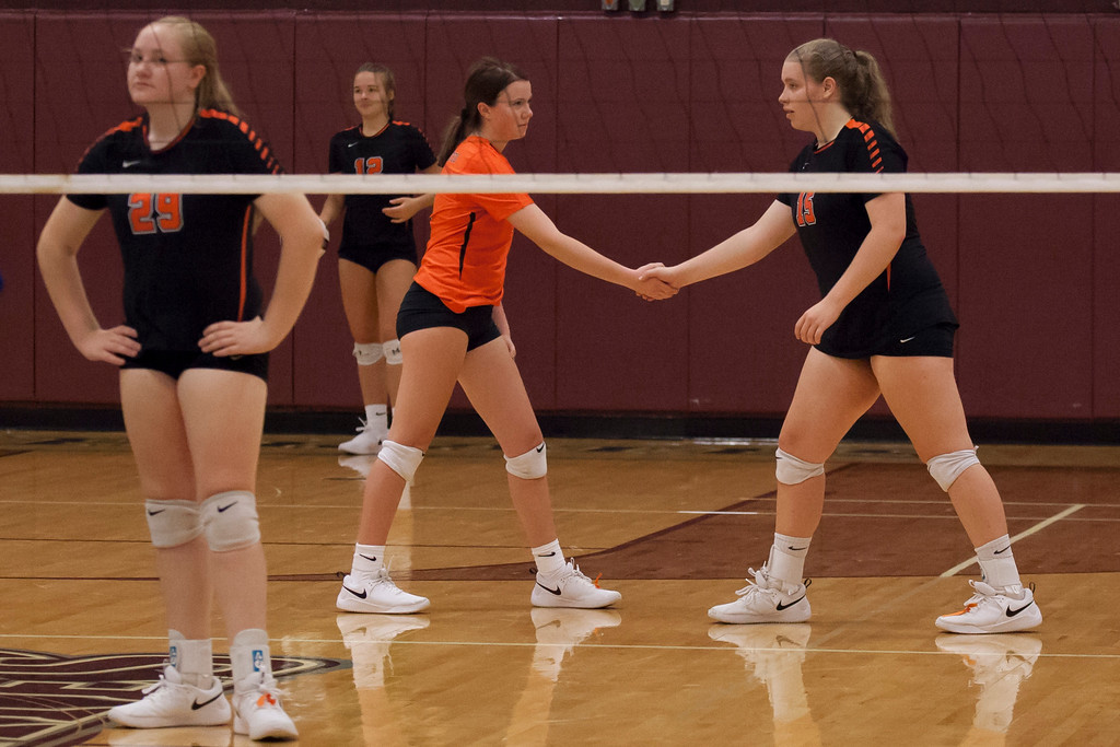 . Jen Forbus - The Morning Journal<br> North Olmsted\'s Natalie Kennedy, right, and Sadee Schlund take their position as the Eagles prepare to serve against the Trinity Trojans on Sept. 8.