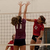 Jen Forbus - The Morning Journal<br> Fairview's Abby Kuyper smashes the ball over the net as Wellington's Erin Frenk tries to block on Sept. 8.