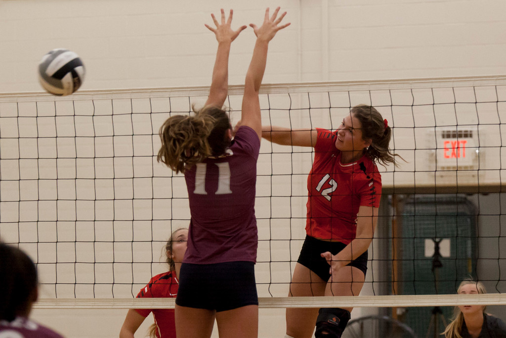 . Jen Forbus - The Morning Journal<br> Fairview\'s Abby Kuyper smashes the ball over the net as Wellington\'s Erin Frenk tries to block on Sept. 8.