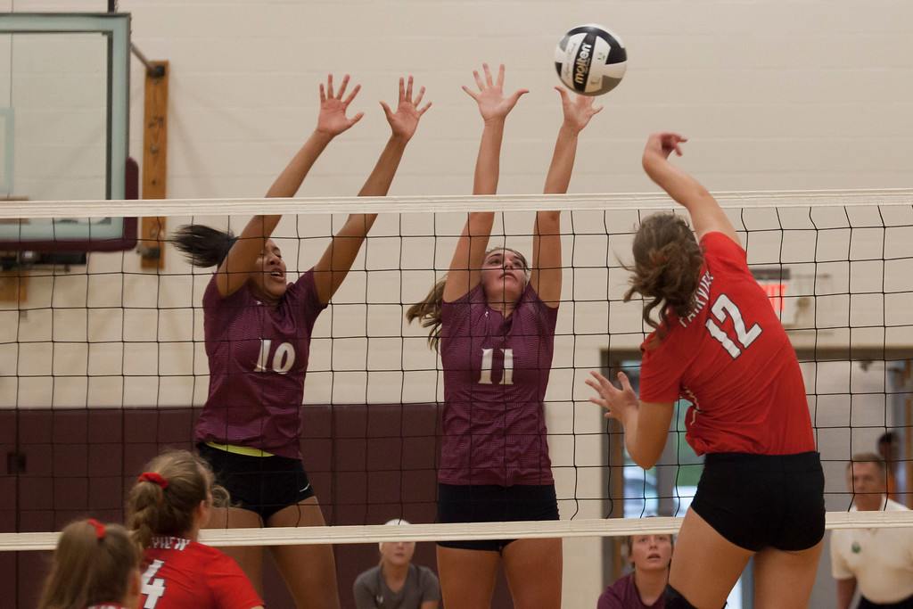 . Jen Forbus - The Morning Journal<br> Wellington\'s Jalen Gibbs and Erin Frenk attempt to block the shot from Fairview\'s Abby Kuyper on Sept. 8.