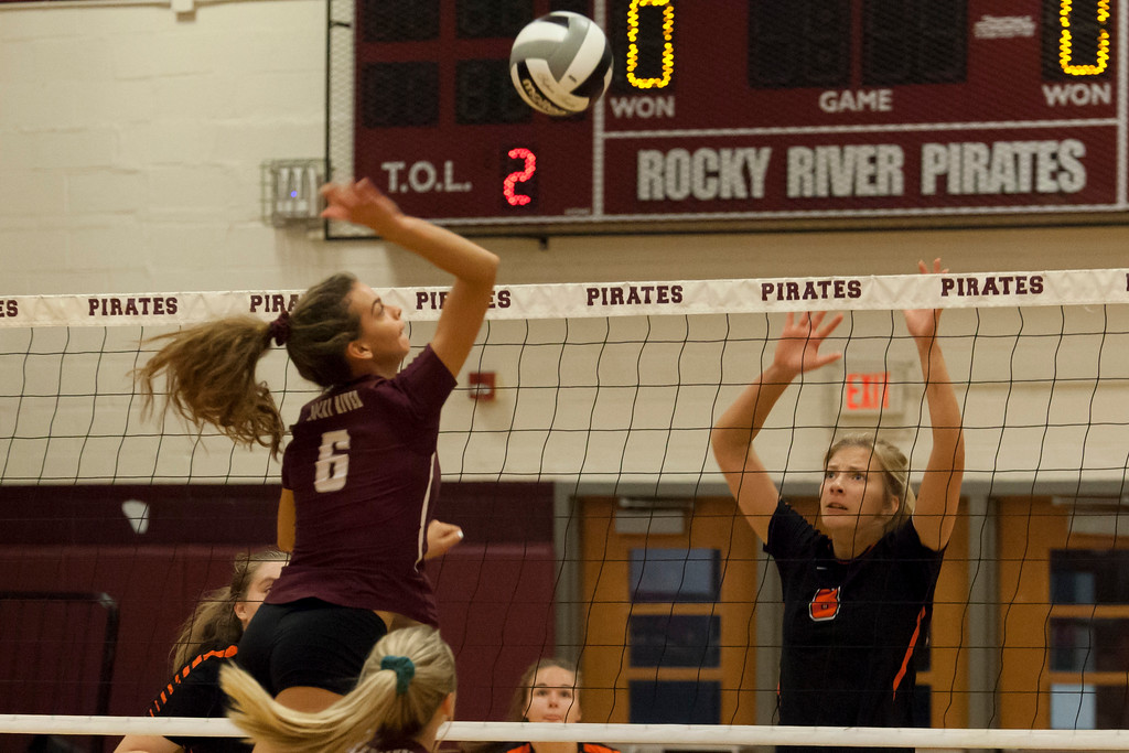 . Jen Forbus - The Morning Journal<br> North Olmsted\'s Zinta Frigic anticipates a spike from Rocky River\'s Ava Rauser on Sept. 8.