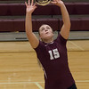 Jen Forbus - The Morning Journal<br> Rocky River's Marissa Smiley sets the ball during the Pirates' match against North Olmsted on Sept. 8.