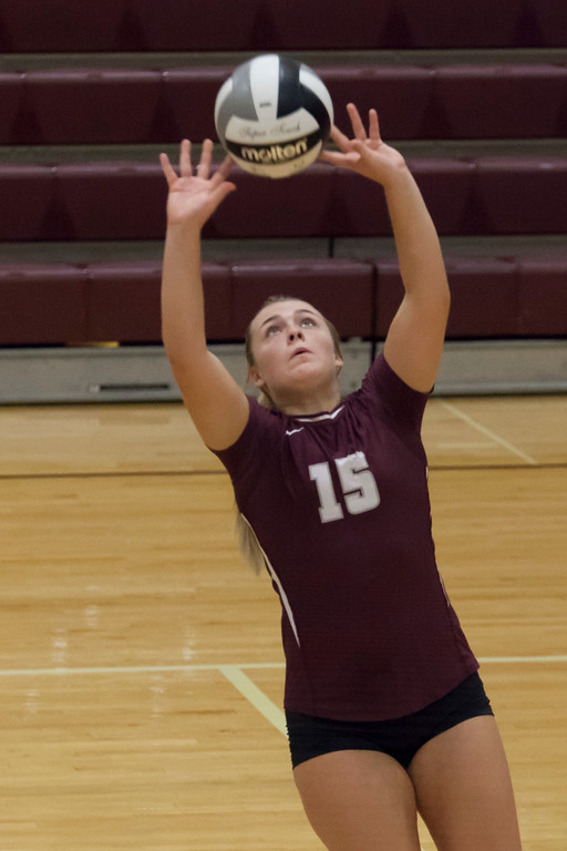 . Jen Forbus - The Morning Journal<br> Rocky River\'s Marissa Smiley sets the ball during the Pirates\' match against North Olmsted on Sept. 8.