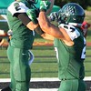 Randy Meyers - The Morning Journal<br /> Westlake's Conner Sterneckert is congratulated by teamate Q'Darr Robinson after scoring a first quarter touchdown against Avon Lake on Sept. 9.