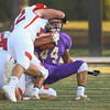 Eric Bonzar—The Morning Journal<br /> Vermilion wide receiver Jonah Pfeil (44) is smothered by the Firelands defense, Sept. 9, 2016.