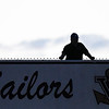 Eric Bonzar—The Morning Journal<br /> A fan watches the Sailors' football game against the Firelands Falcons from atop the stands, Sept. 9, 2016.