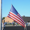 Eric Bonzar—The Morning Journal<br /> Albert Chaser, left, and Doug Brown, National Officer of Amvets Post 22, raise the American flag prior to the start of the Sailors' football game against the Firelands Falcons, Sept. 9, 2016.