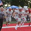 David Turben- The News-Herald<br /> The Mentor football team runs onto the field before its game against St. Xavier on Sept. 9.