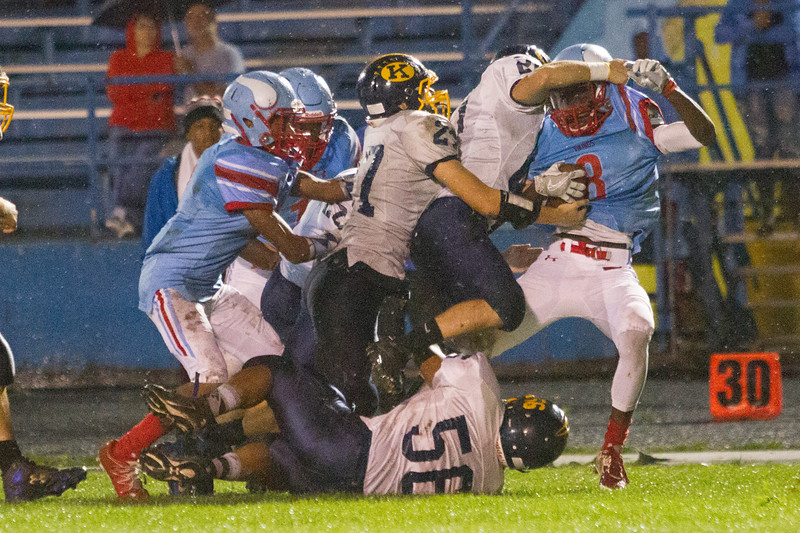 Barry Booher - The News-Herald<br /> VASJ Brandan Samsa, gets driven back by the Kirtland defense for a four yard loss Sept. 10 at Euclid.