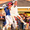 Barry Booher - The News-Herald<br /> Perry's Andrew Foley intercepts a pass over teammate Josh Petruccelli, and Madison's Alex Caswell.