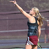 Avon Lake's Bianca Henline tosses up a ball for a serve against Amherst in a doubles match. Randy Meyers -- The Morning Journal