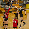 Barry Booher - The News-Herald<br /> Riverside's Cassie Jordan taps over Isabelle LeMaster.