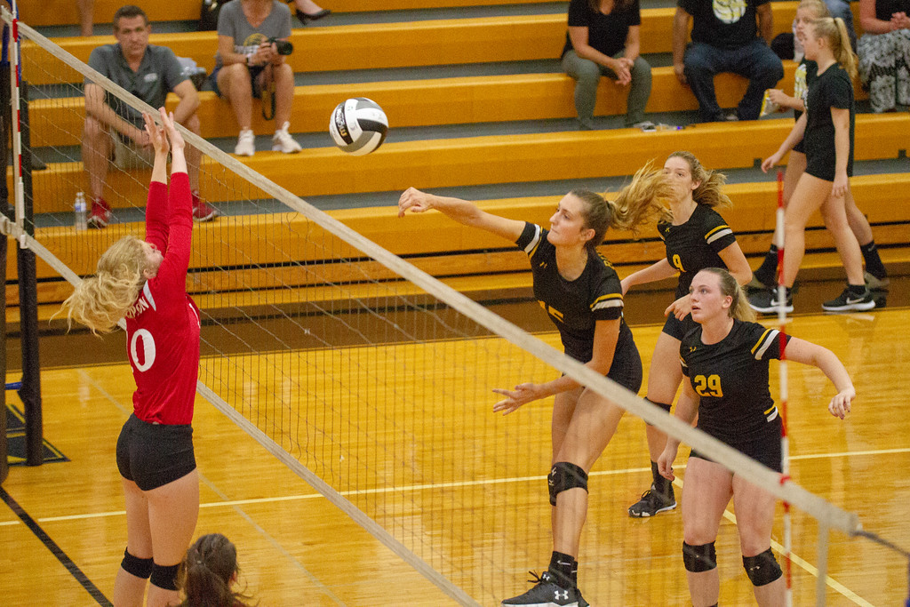 . Barry Booher - The News-Herald Chardon\'s Anna Thompson goes for the block against Riverside\'s Jen Sivak.