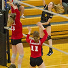 Barry Booher - The News-Herald<br /> Riverside's Olivia Bell spikes on Chardon's (23) Audrey Kostelac and (11) Isabelle LeMaster.