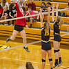 Barry Booher - The News-Herald<br /> Chardon's Audrey Kostelac gets ready to spike over (15) Jen Sivak and Olivia Bell.