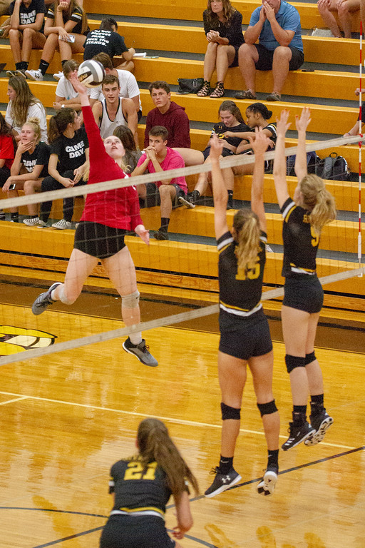 . Barry Booher - The News-Herald Chardon\'s Audrey Kostelac gets ready to spike over (15) Jen Sivak and Olivia Bell.