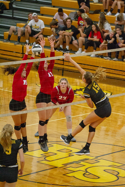 Barry Booher - The News-Herald<br /> Chardon's (15) Erin Martin and (11) Isabelle LeMaster go up against Riverside's Jen Sivak.