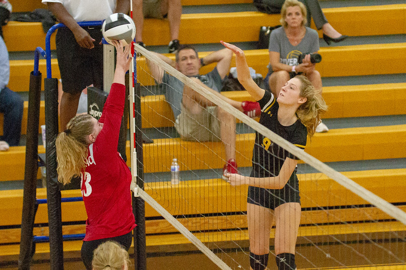 Barry Booher - The News-Herald<br /> Riverside's Olivia Bell scores over Chardon's Audrey Kostelac.