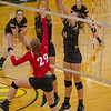 Barry Booher - The News-Herald<br /> Chardon's Flora Frieden tries tipping the ball over Riverside's (15) Jen Sivak, and Kate Tracz.