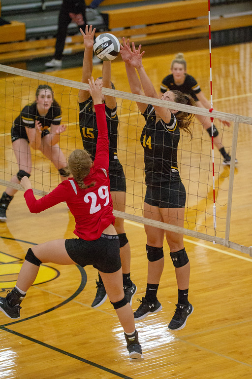 . Barry Booher - The News-Herald Chardon\'s Flora Frieden tries tipping the ball over Riverside\'s (15) Jen Sivak, and Kate Tracz.