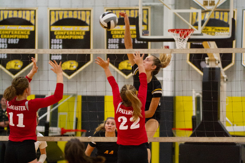 Barry Booher - The News-Herald<br /> Riverside's Jen Sivak spikes against (11) Isabelle LeMaster and Ashley Paterson.