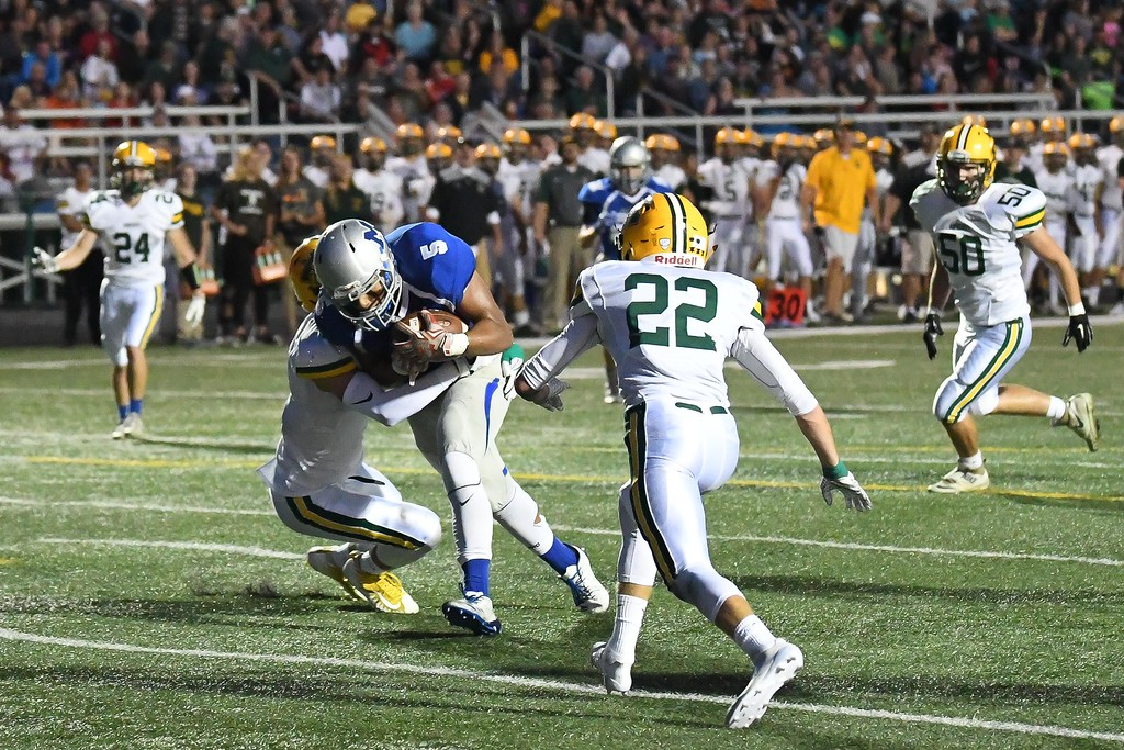 . Eric Bonzar�The Morning Journal<br> Midview receiver Alonzo Banks (5) plows his way in to the end zone for a touchdown, Sept. 15, 2017.