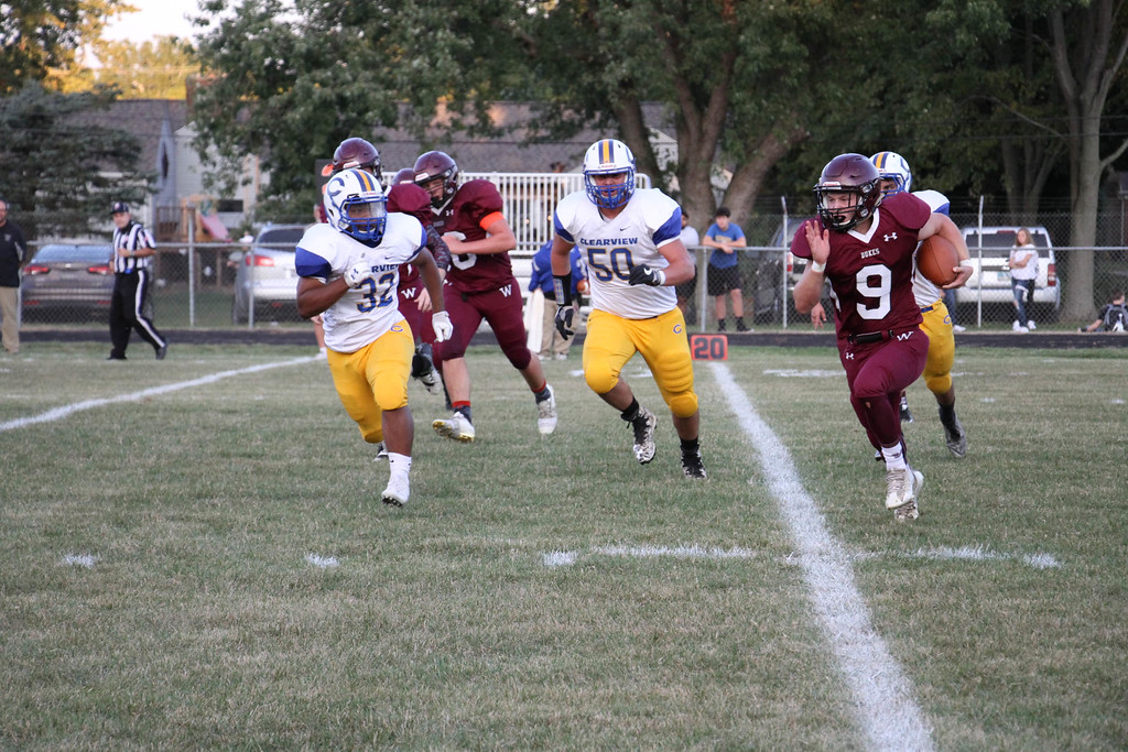 . Nicholas Pfeifer - The Morning Journal<br> Wellington quarterback Mason Wright scrambles left to avoid being sacked by Clearview on Sept. 15.