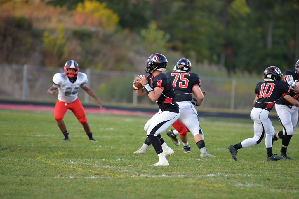 . Aimee Bielozer - The Morning Journal<br> Brookside quarterback Jonathan Hice looks for an open receiver against Oberlin on Sept. 15.