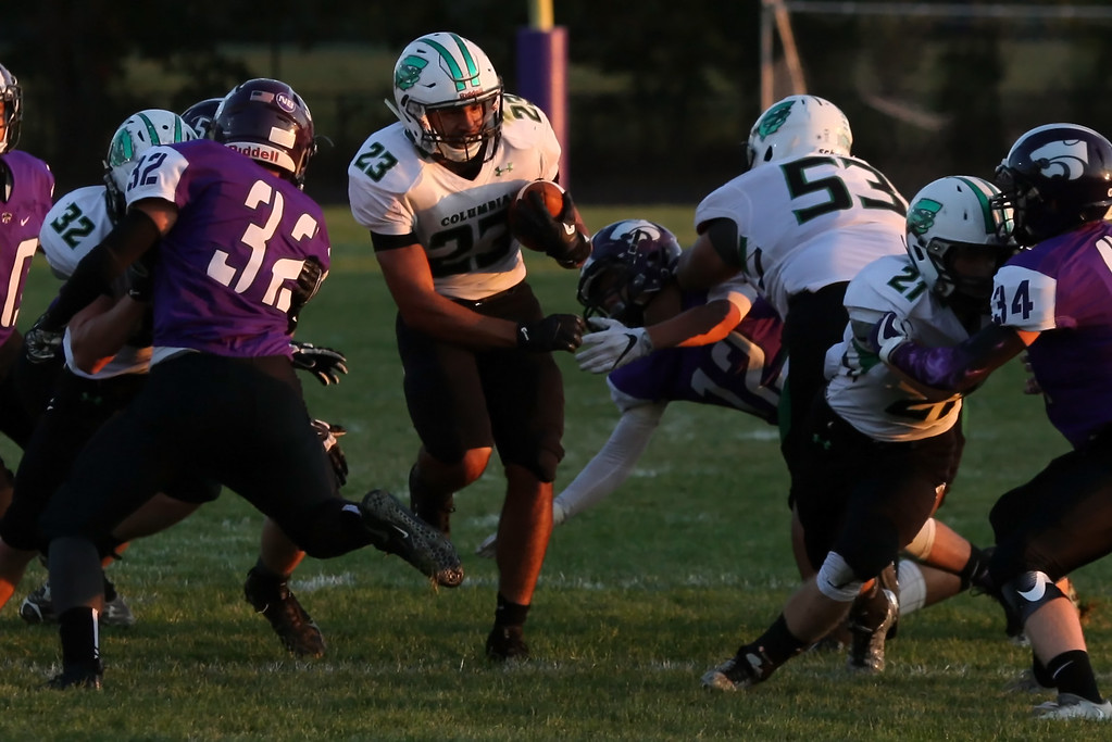 . Randy Meyers - The Morning Journal<br> Columbia running back Brandon Coleman picks up blocks from his offensive line against Keystone for a gain during the first quarter on Sept. 15.