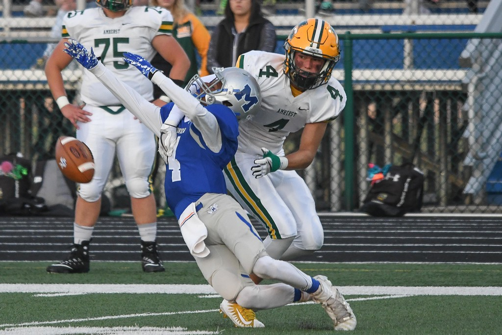 . Eric Bonzar�The Morning Journal<br> Amherst\'s Hunter Cassidy (4) is called for pass interference on Midview\'s Isiah Johnson (4), Sept. 15, 2017.