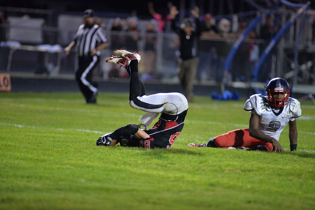 . Aimee Bielozer - The Morning Journal<br> Brookside\'s David Chambers rumbles over Oberlin\'s Devon Yarber for a touchdown on Sept. 15.