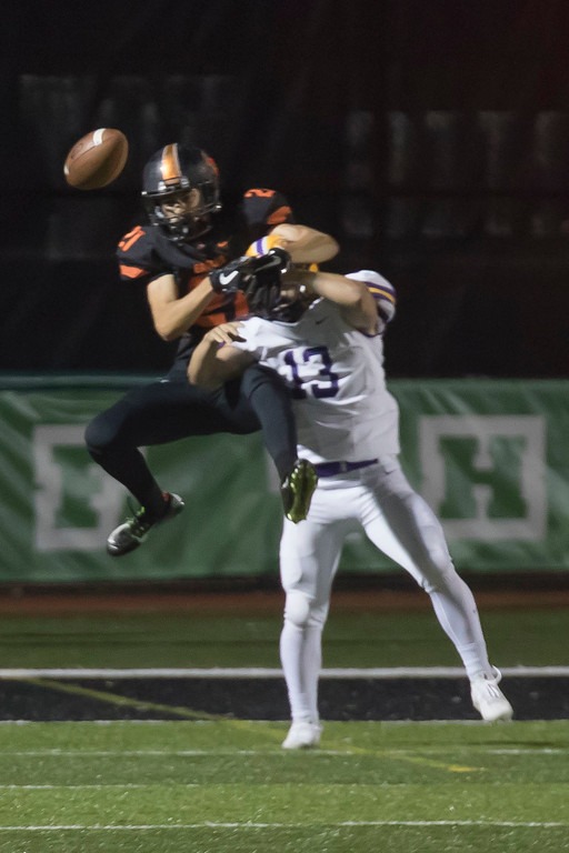 . Jen Forbus - The Morning Journal<br> Avon\'s Jackson Myers tries to prevent a completed pass to North Olmsted wide receiver Lucas Servidio on Sept. 15.