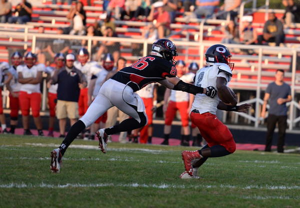 . Aimee Bielozer - The Morning Journal<br> Oberlin\'s Devan Yarber is brought down from behind against Brookside on Sept. 15.