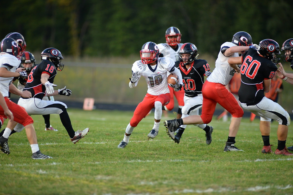 . Aimee Bielozer - The Morning Journal<br> Oberlin\'s Aaron Arnold runs though a gap against Brookside on Sept. 15.