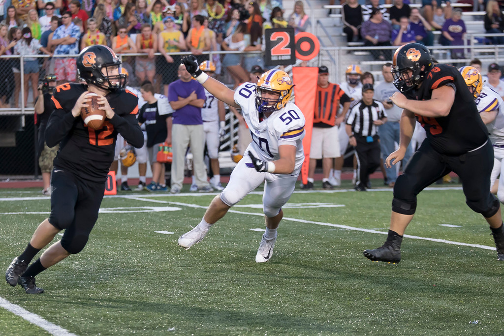 . Jen Forbus - The Morning Journal<br> Avon\'s Max Torbert rushes North Olmsted quarterback Liam Fay on Sept. 15.