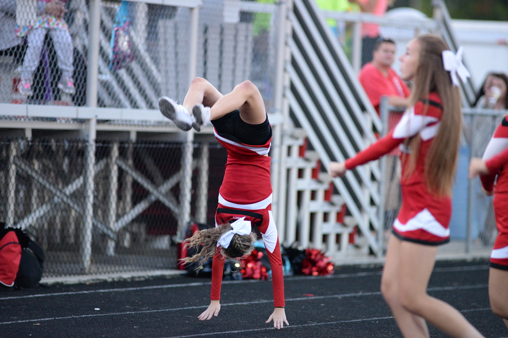 . Aimee Bielozer - The Morning Journal<br> A Brookside cheerleader does a flip on Sept. 15.