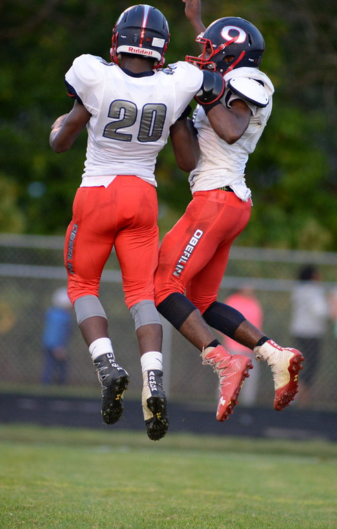 . Aimee Bielozer - The Morning Journal<br> Oberlin\'s Ravon Eisom (20) and Devan Yarber celebrate a touchdown against Brookside on Sept. 15.
