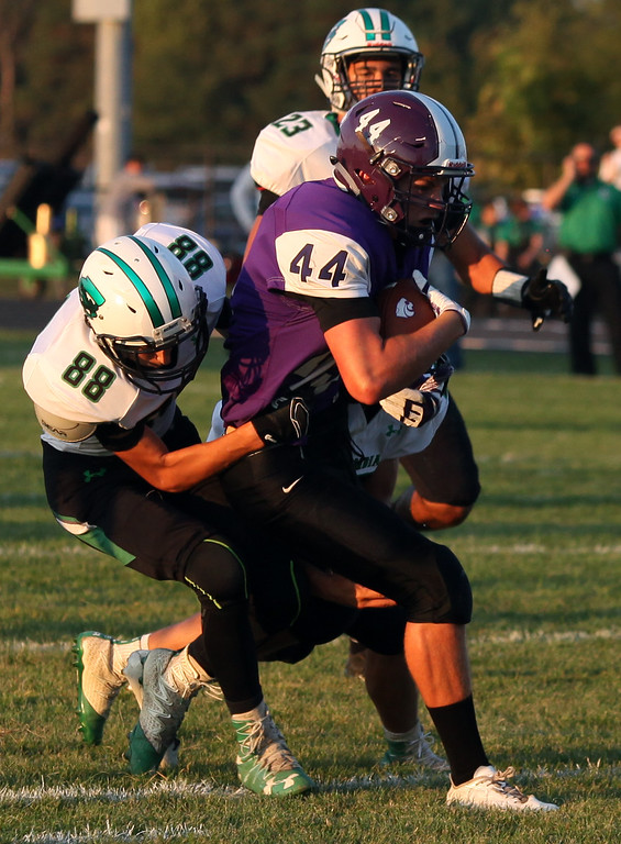 . Randy Meyers - The Morning Journal<br> Columbia\'s Adam Ross tackles Dalton Weber of Keystone in the open field during the first quarter on Sept. 15.